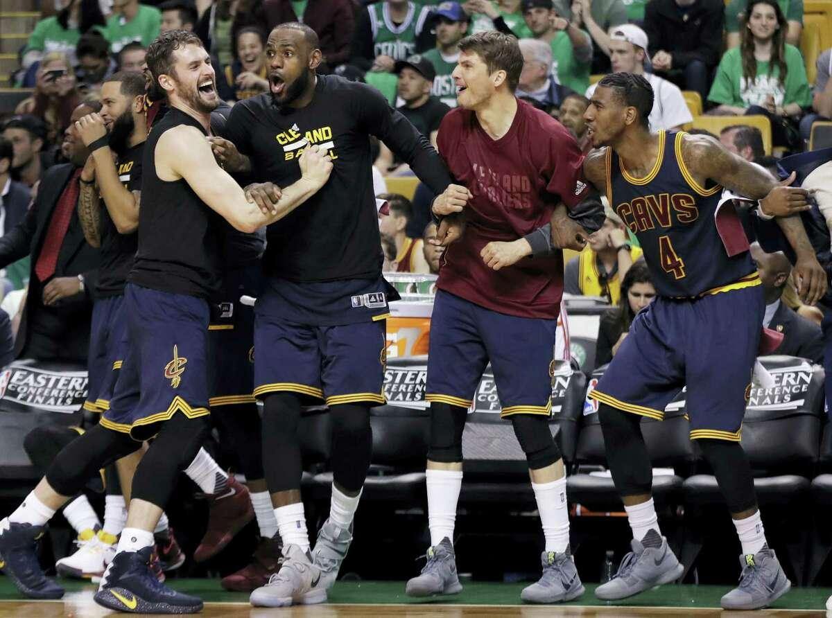 From left, Kevin Love, LeBron James, Kyle Korver and Iman Shumpert celebrate during Game 5 of the Eastern Conference finals.