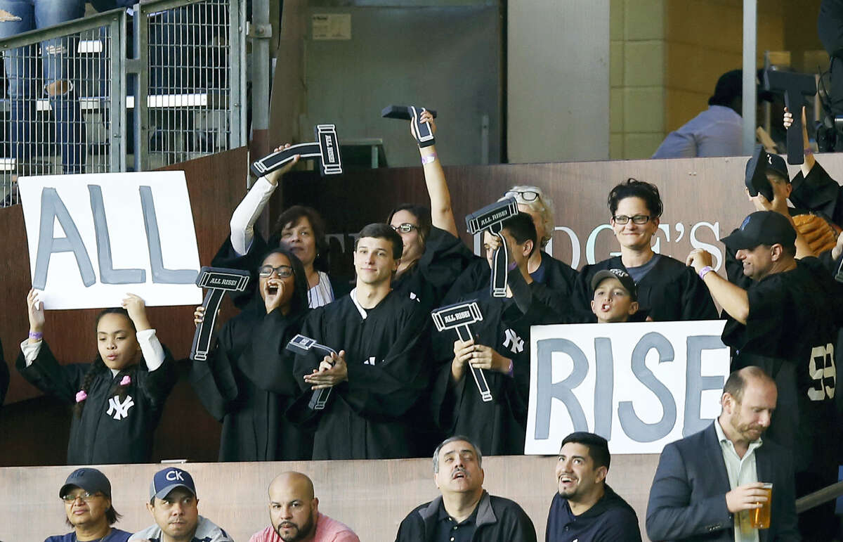 """Yankees fans occupy """"The Judge's Chambers"""" section above right field at Yankee Stadium."""