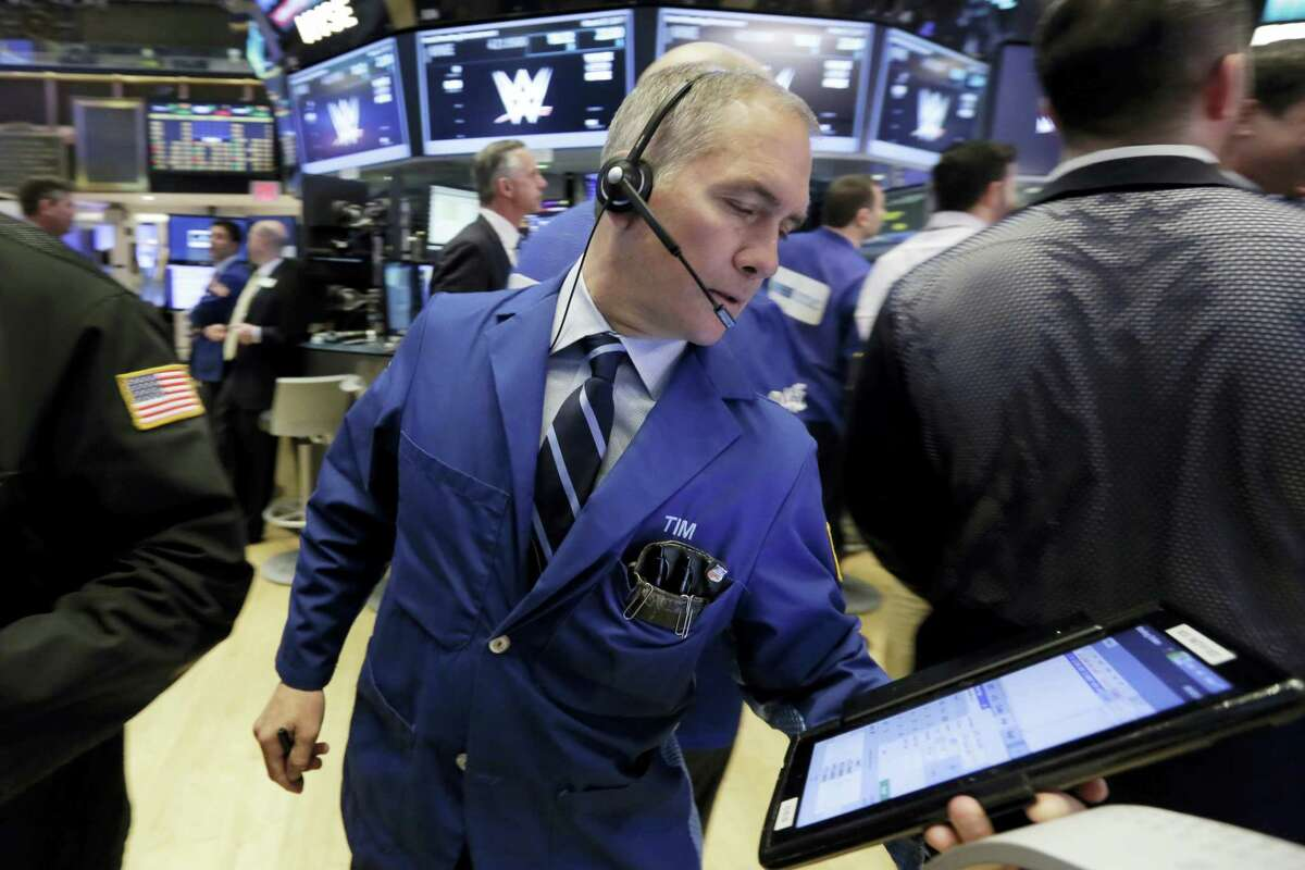 Trader Timothy Nick works on the floor of the New York Stock Exchange Monday.