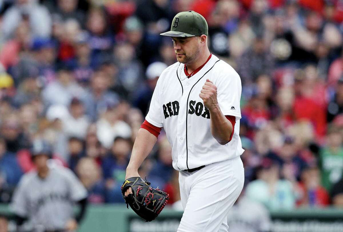Red Sox starting pitcher Brian Johnson pumps his fist after completing the top of the eighth inning on Saturday.