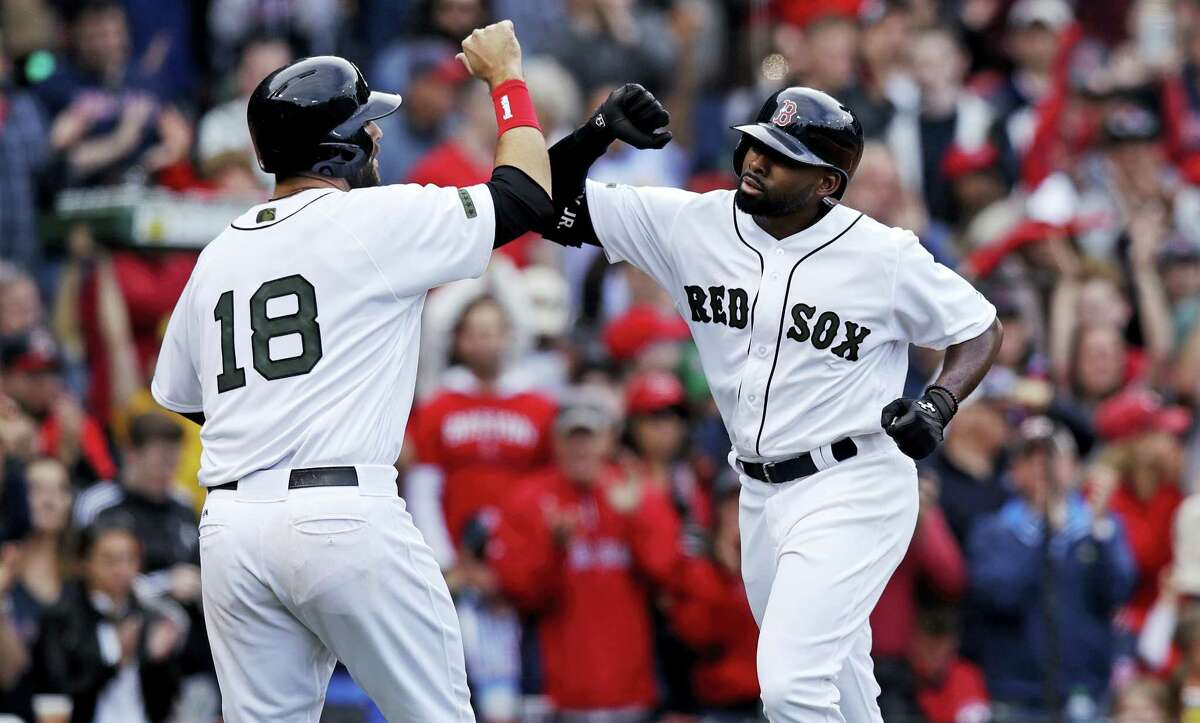 Jackie Bradley Jr., right, is congratulated by Mitch Moreland (18) after his two-run home run in the sixth inning Saturday.