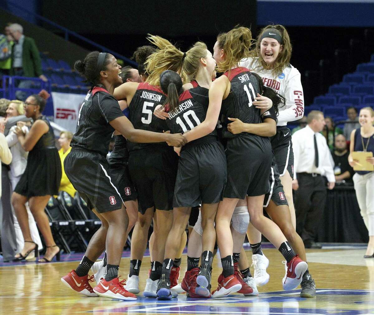 Members of the Stanford women's team celebrate after defeating Notre Dame to advance to the Final Four on Sunday.