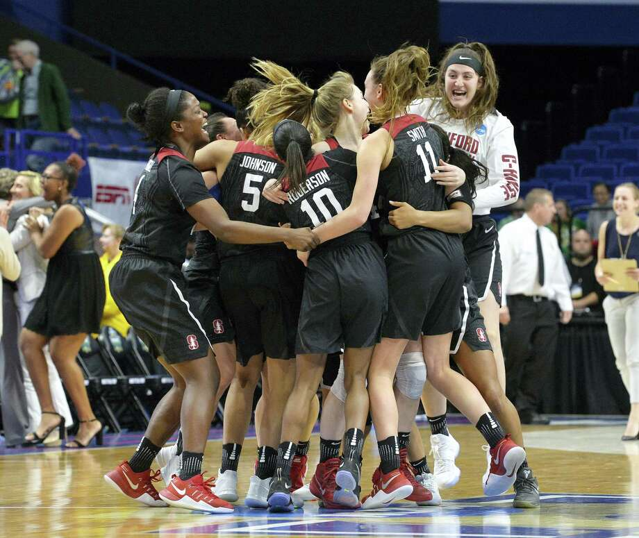 Members of the Stanford women's team celebrate after defeating Notre Dame to advance to the Final Four on Sunday. Photo: Timothy D. Easley — The Associated Press  / FR43398 AP