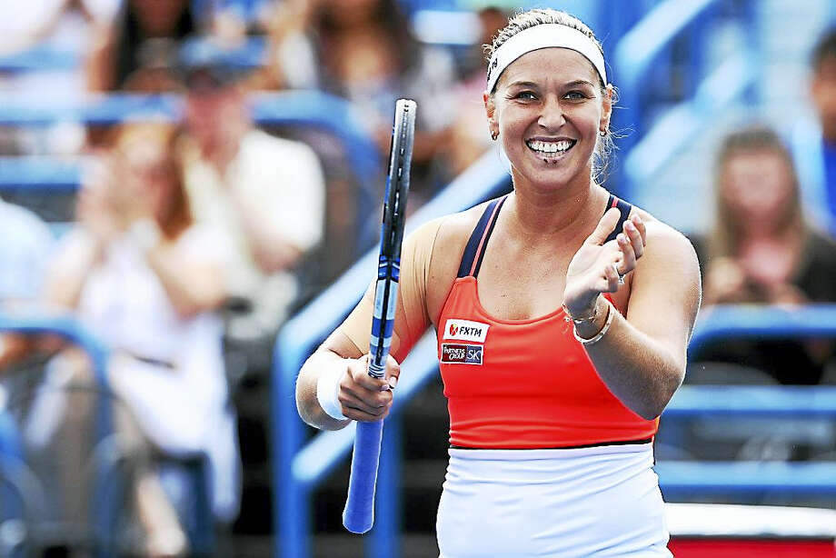Dominika Cibulkova celebrates after defeating Elise Mertens in the semifinals of the Connecticut Open on Friday. Photo: Maddie Meyer/Getty Images