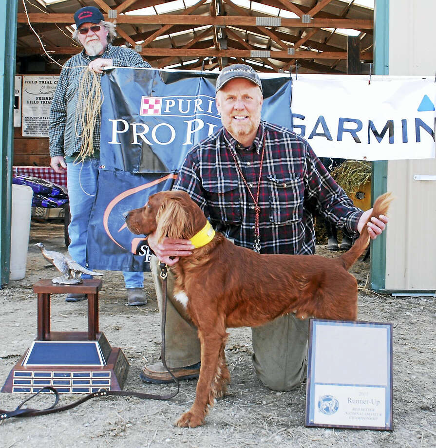 Harwinton resident Gregor McCluskey and his Red Setter, Braeval Laddie, recently won a highly competitive bird dog field trial championship in Illinois. Photo: Contributed Photo — Gregor McCluskey