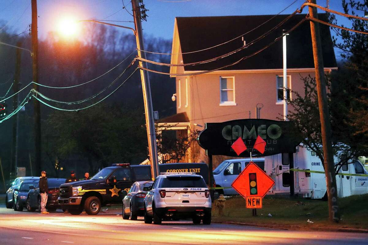 A coroner's unit pulls away as police operate at a crime scene outside the Cameo club after a fatal shooting on March 26, 2017 in Cincinnati.