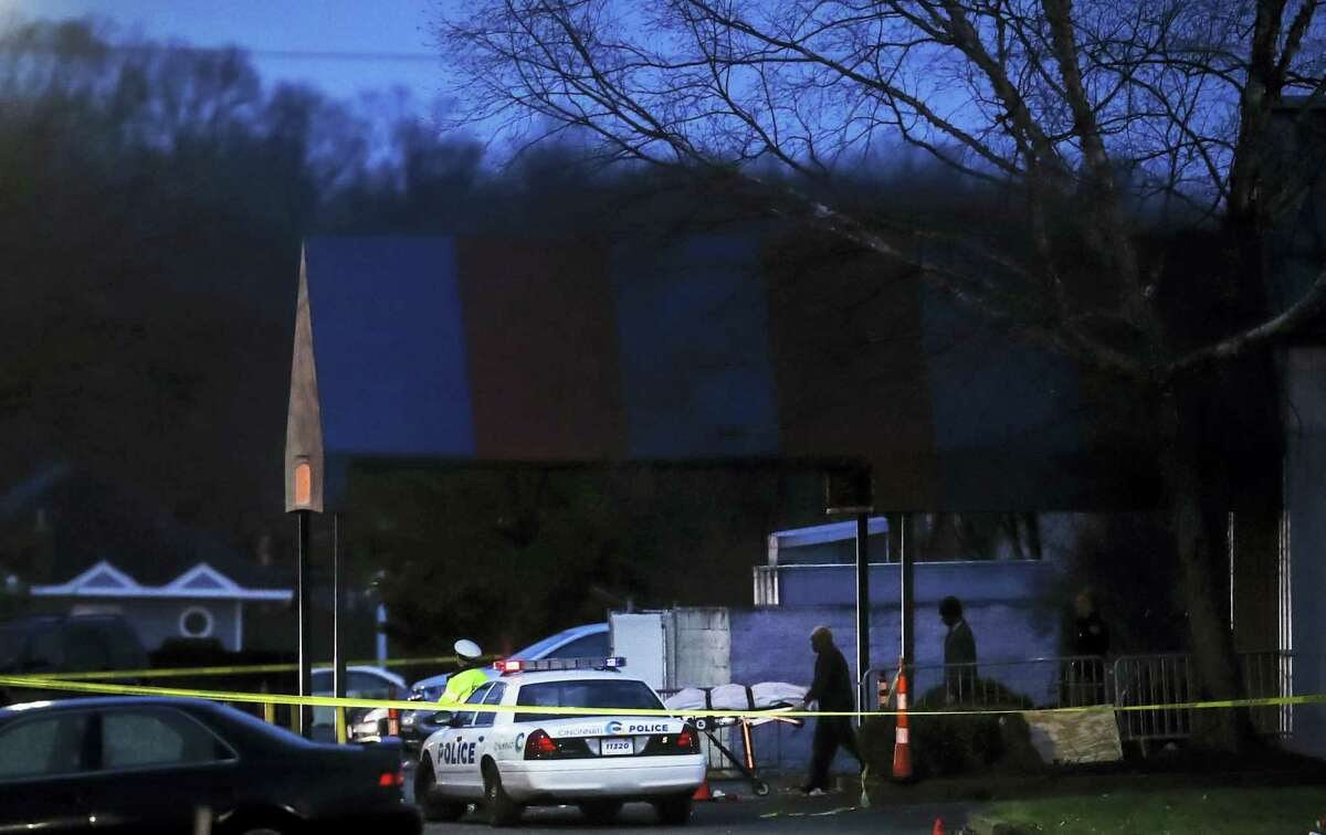 A body is removed as police operate at a crime scene outside the Cameo club after a fatal shooting on March 26, 2017 in Cincinnati.