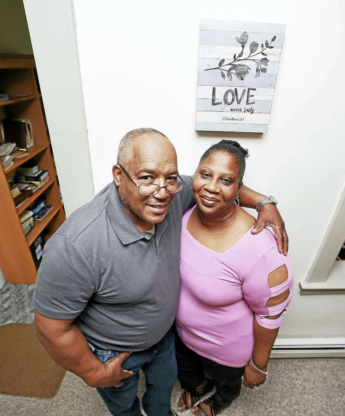 (Arnold Gold-New Haven Register) Foster parents Ural Hunter and his wife, Kim Boyd-Hunter, are photographed in their home in New Haven on 5/23/2017.