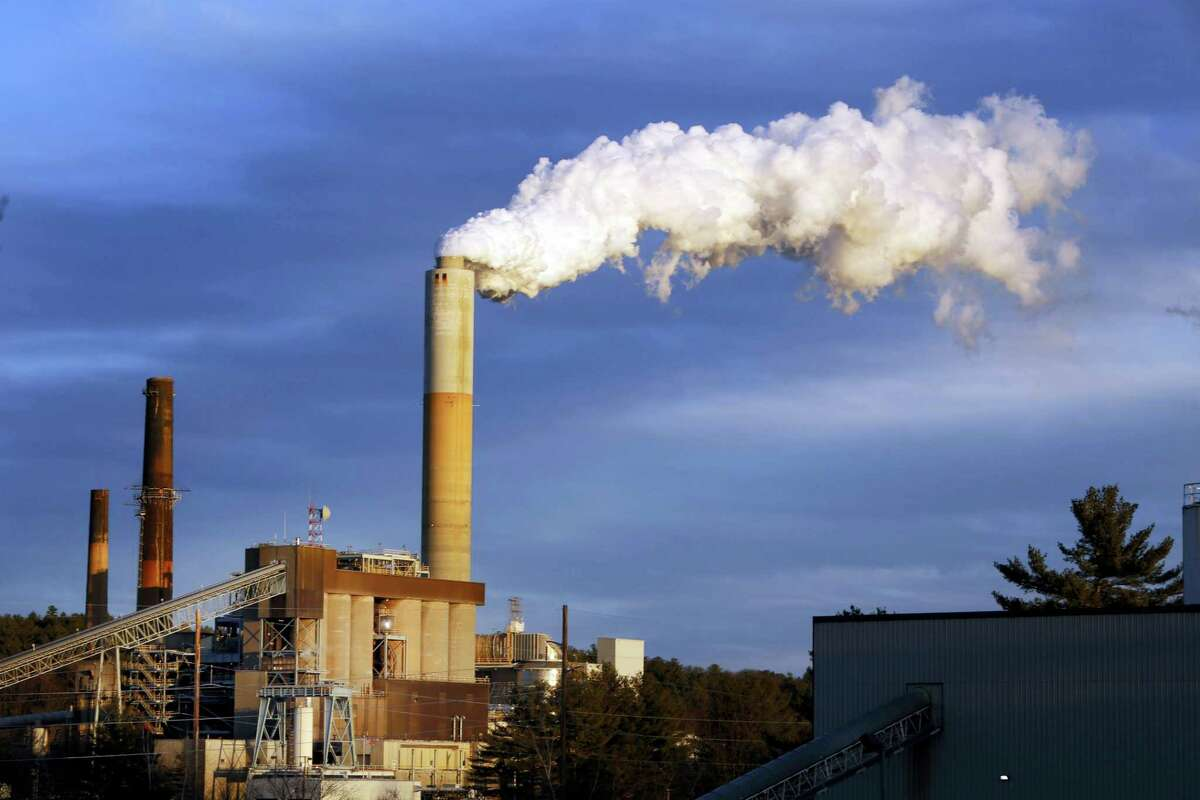 A plume of steam billows from the coal-fired Merrimack Station in Bow, N.H. Earth is likely to hit more dangerous levels of warming even sooner if the U.S. pulls back from its pledge to cut carbon dioxide pollution because America contributes so much to rising temperatures, scientists said.
