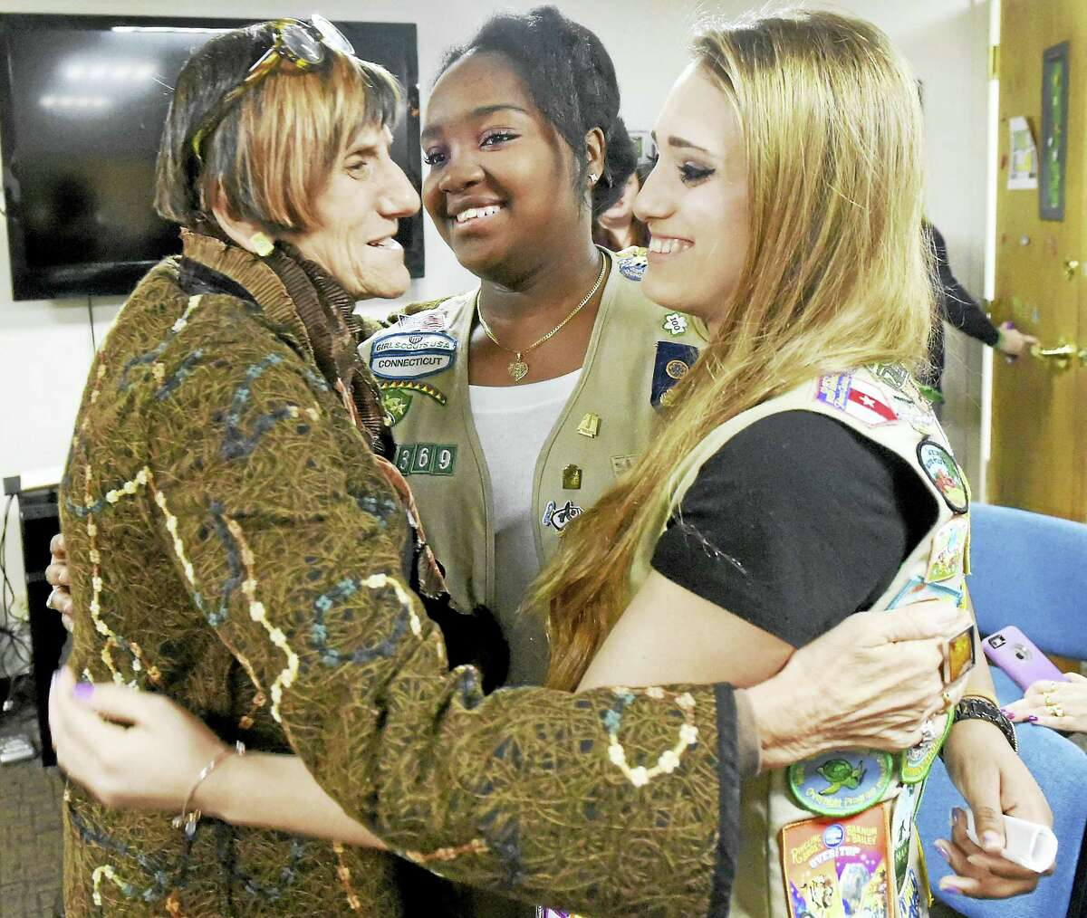 Congresswoman Rosa DeLauro (D-CT03), left, embraces Girl Scout Gold Award recipients Jenelle Grant, 17, of Milford, center, and Helen Ruckes, 17, of Orange, right, as DeLauro joined the Girl Scouts of Connecticut as the official Girl Scouts of Connecticut spokesperson for the Gold Award on January 19, 2016 in their North Haven headquarters to kickoff the 100th Anniversary of the Girl Scout Gold Award nationwide.