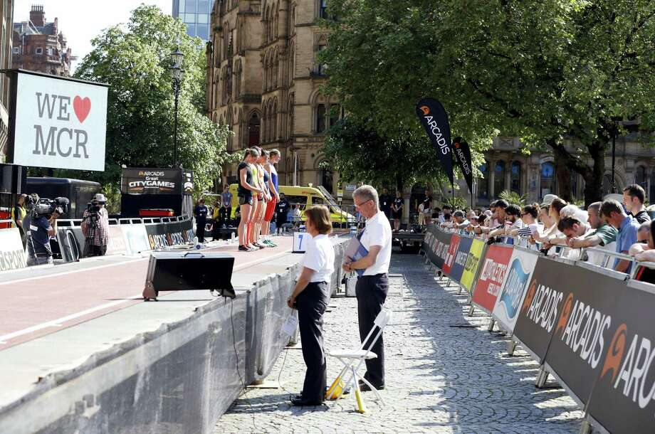 A minute's silence is held on Friday in memory of the victims of the Manchester concert blast. Photo: Martin Rickett — PA Via AP  / PA Wire
