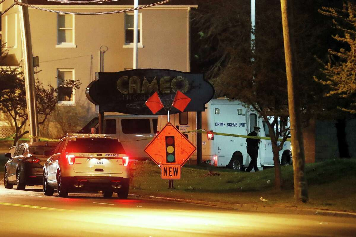 Police operate at a crime scene outside the Cameo Nightclub after a reported fatal shooting, Sunday, March 26, 2017, in Cincinnati. At least two people opened fire inside a crowded nightclub early Sunday morning. (AP Photo/John Minchillo)