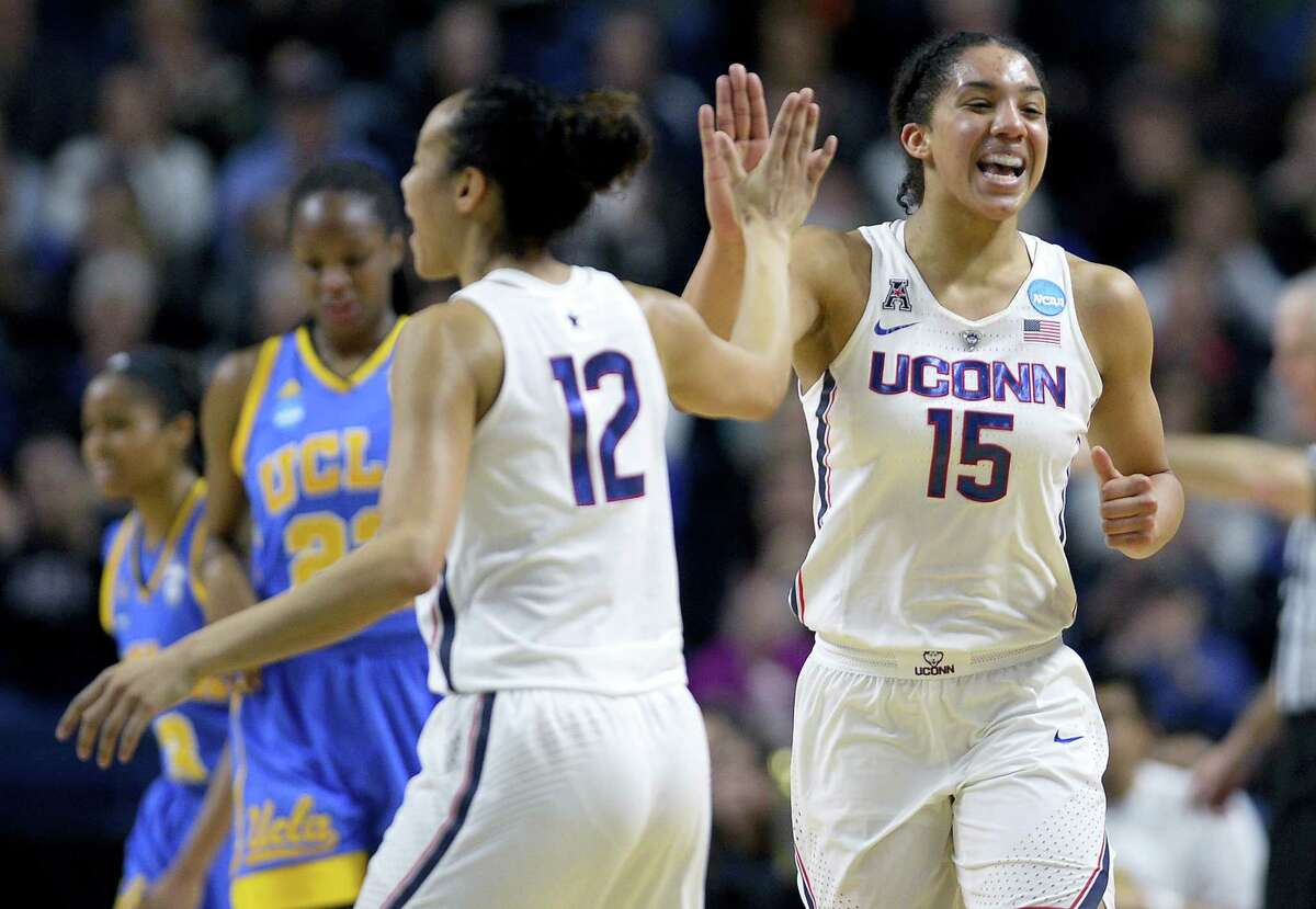 UConn's Saniya Chong, left, and Gabby Williams celebrate a basket against UCLA during the first half Saturday in Bridgeport.