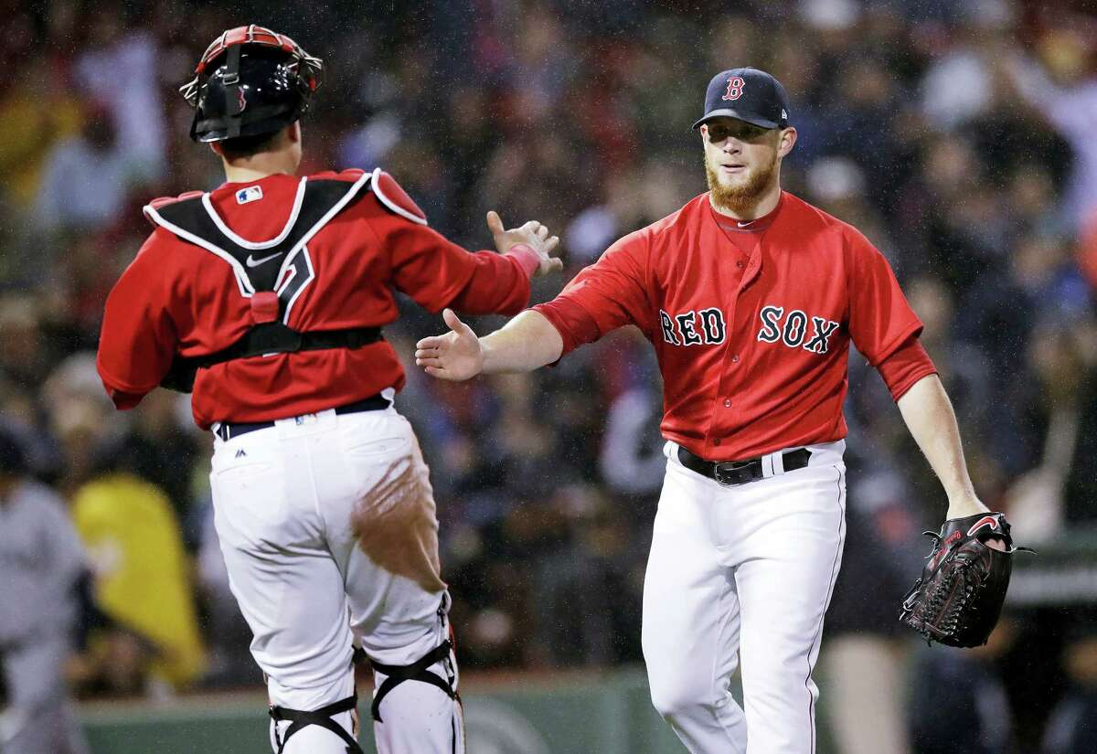 Red Sox closer Craig Kimbrel, right, is congratulated by catcher Christian Vazquez after Friday's win.