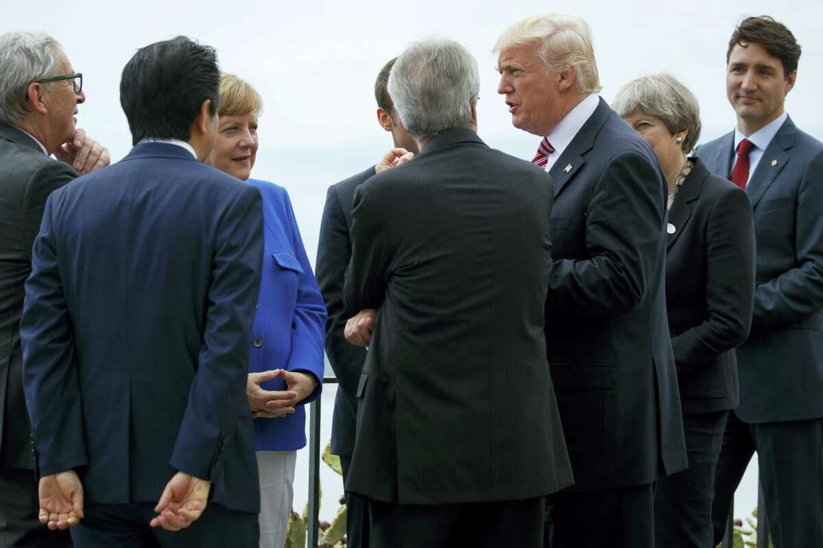 President Donald Trump poses for photos with G7 leaders at the Ancient Greek Theater of Taormina during the G7 Summit, Friday, May 26, 2017, in Taormina, Italy.