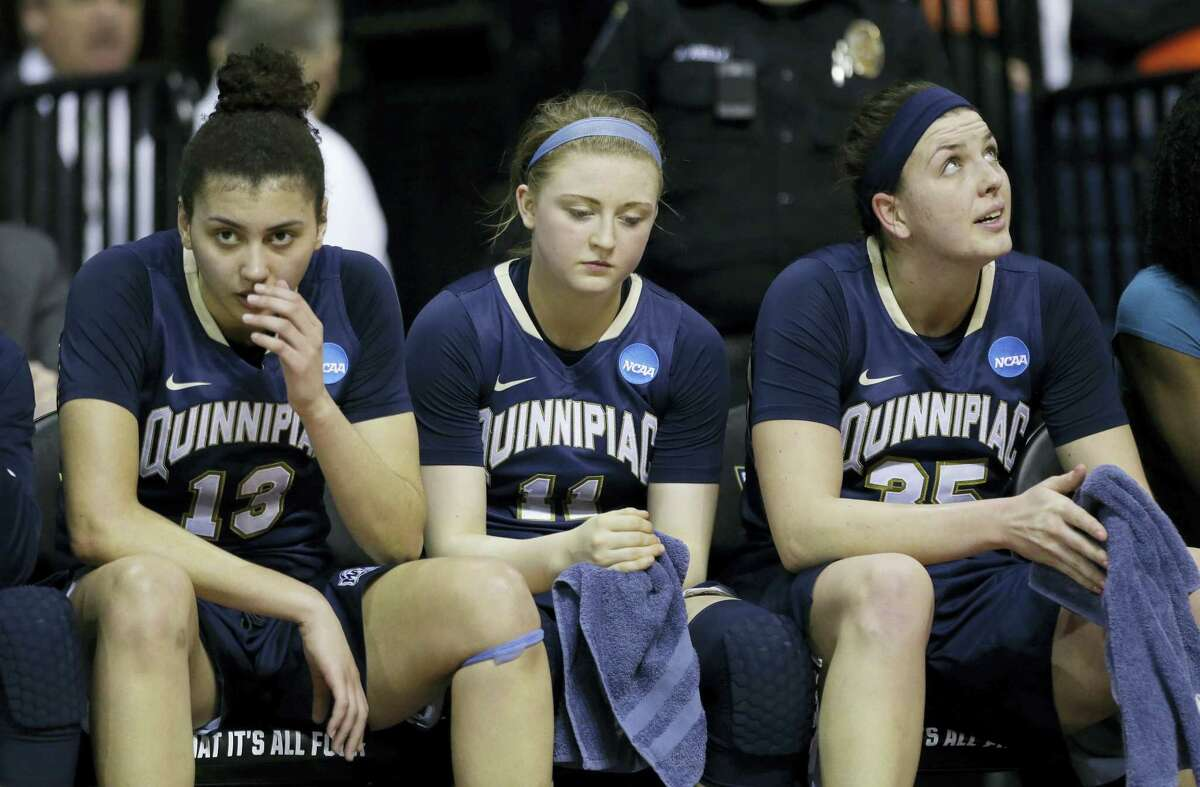 From left, Quinnipiac's Sarah Shewan, Edel Thornton, and Morgan Manz sit on the bench late in the second half of Saturday's regional semifinal against South Carolina in Stockton, California.