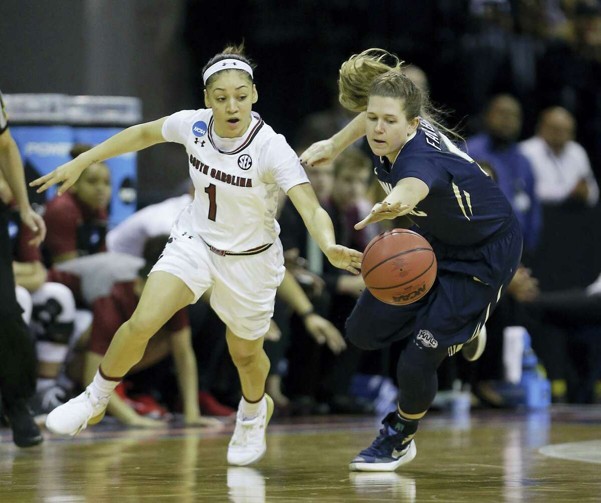 South Carolina's Bianca Cuevas-Moore, left, and Quinnipiac's Carly Fabbri scramble for the ball during the first half Saturday.