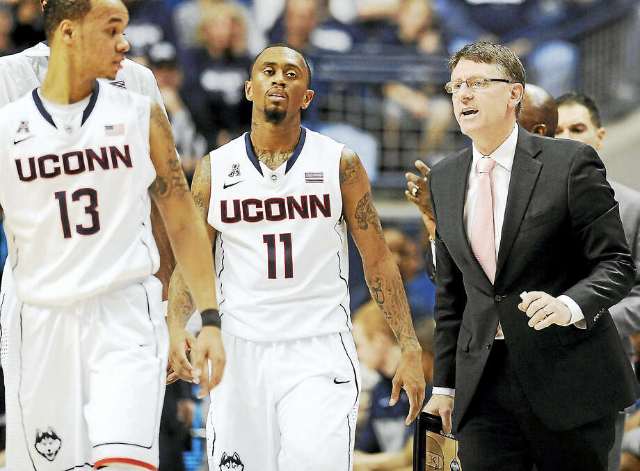 UConn associate head coach Glen Miller, right, has left the program. Photo: The Associated Press File Photo  / AP2013
