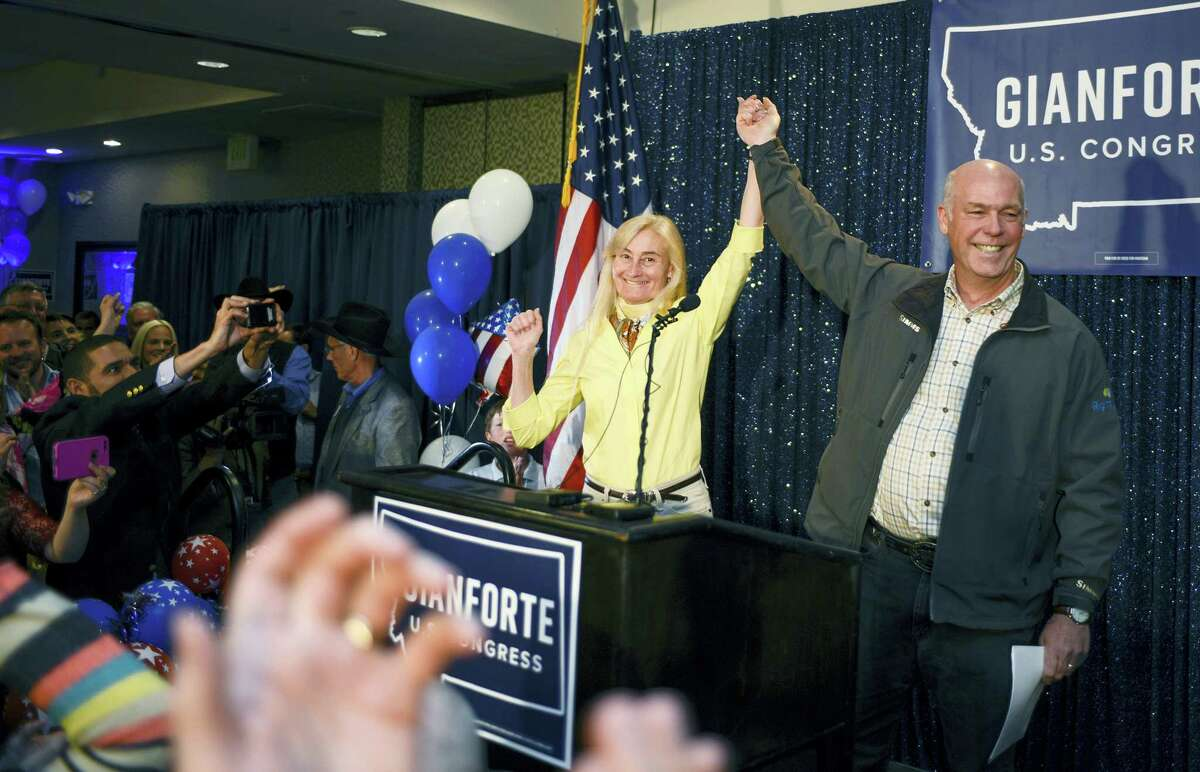 Greg Gianforte, right, and wife Susan, center, celebrate his win over Rob Quist for the open congressional seat at the Hilton Garden Inn Thursday night, May 25, 2017, in Bozeman, Mont. Gianforte, a technology entrepreneur, defeated Democrat Quist to continue the GOP's two-decade stronghold on the congressional seat.