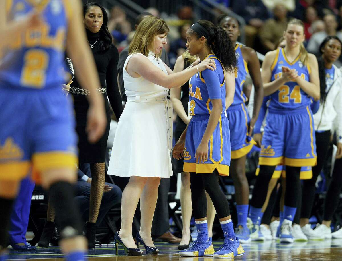 UCLA head coach Cori Close talks with Jordin Canada after she fouled out of Saturday's game against UConn.