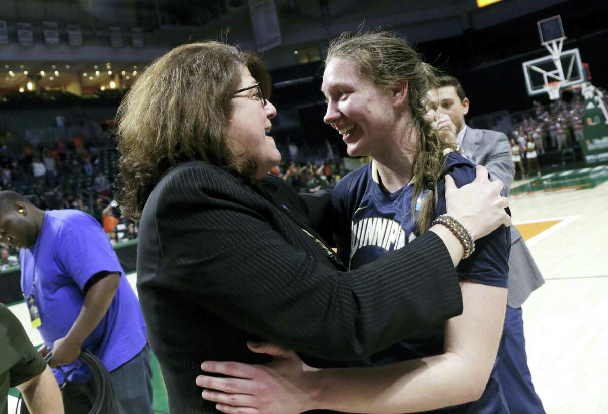 Quinnipiac women's basketball coach Tricia Fabbri, left, hugs Paula Strautmane after their win over Miami in the second round of the NCAA tournament.