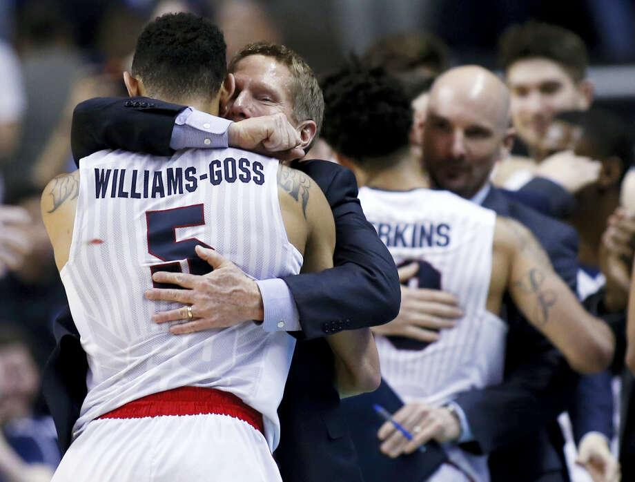 Gonzaga head coach Mark Few hugs guard Nigel Williams-Goss (5) in the closing minutes of a Saturday's win over Xavier. Photo: Tony Avelar — The Associated Press  / FR155217 AP