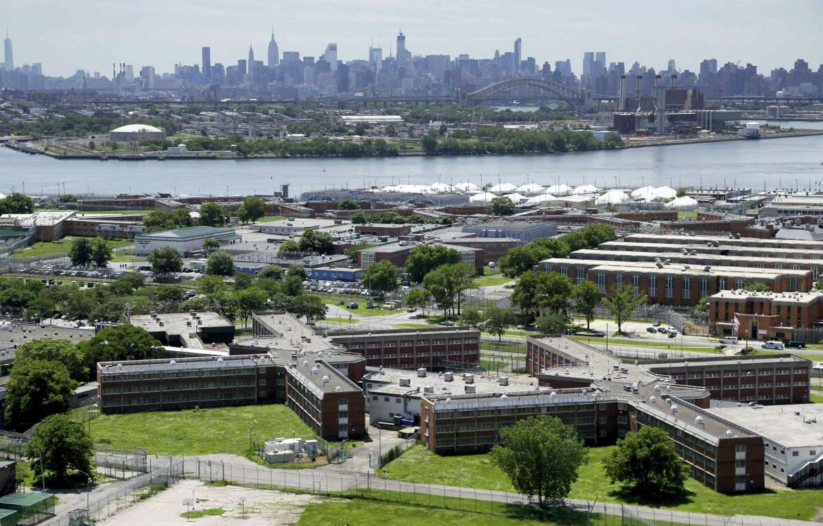 In this this file photo, the Rikers Island jail complex stands in the foreground with the New York skyline in the background. Inmate activists, for more than a year, have argued that shutting down the sprawling, 10-jail complex in the East River is the only solution for a cycle of abuses that include violence by guards and gang members, mistreatment of the mentally ill and juveniles, and unjustly long detention for minor offenders.