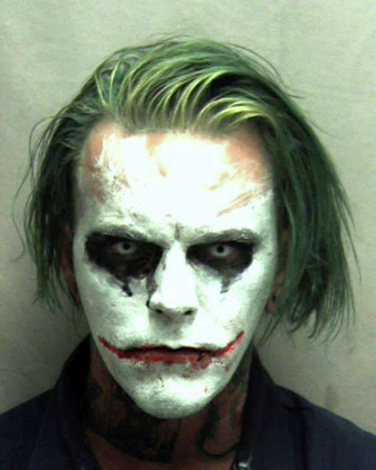 This photo provided by the Winchester Police Department shows Jeremy Putman, who police in Winchester, Va., arrested Friday after callers reported seeing him walking, wearing a cape, carrying a sword and made up as the Batman villain the Joker. Authorities charged Putman with wearing a mask in public, a felony that can result in a sentence of a year in jail.