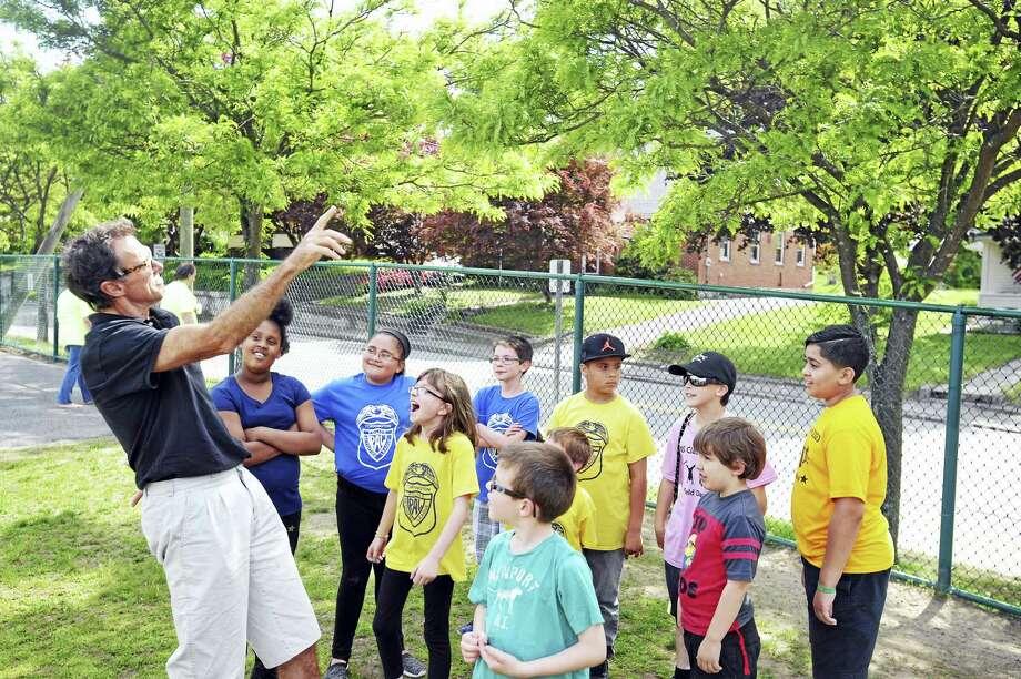 Southwest School students met with former Olympic medalist Rod Dixon, in preparation for the 2017 Kid's Marathon. Photo: Ben Lambert - The Register Citizen