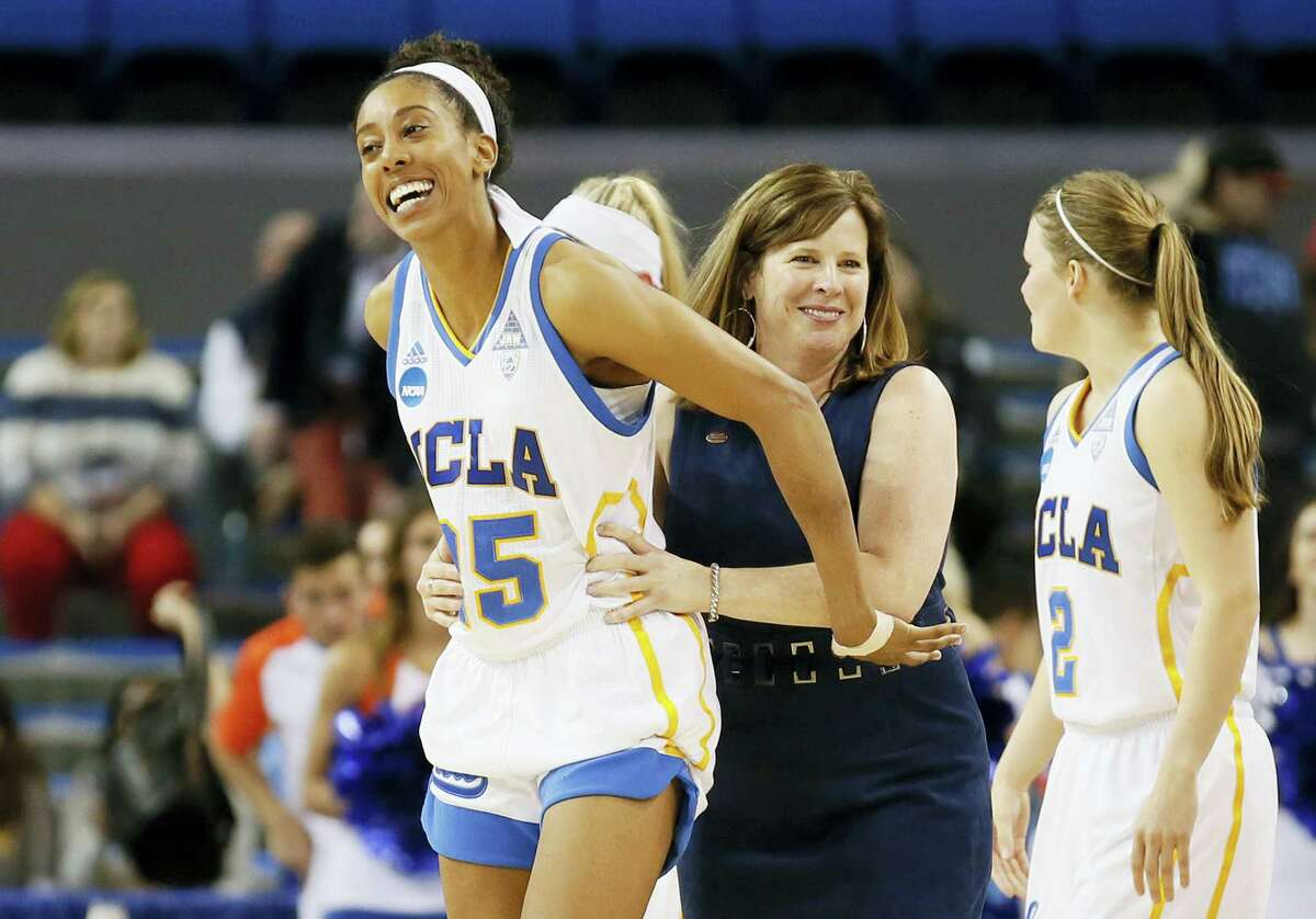 UCLA forward Monique Billings, left, and coach Cori Close, right, smile after UCLA defeated Boise State in an NCAA Tournament first-round game in Los Angeles.