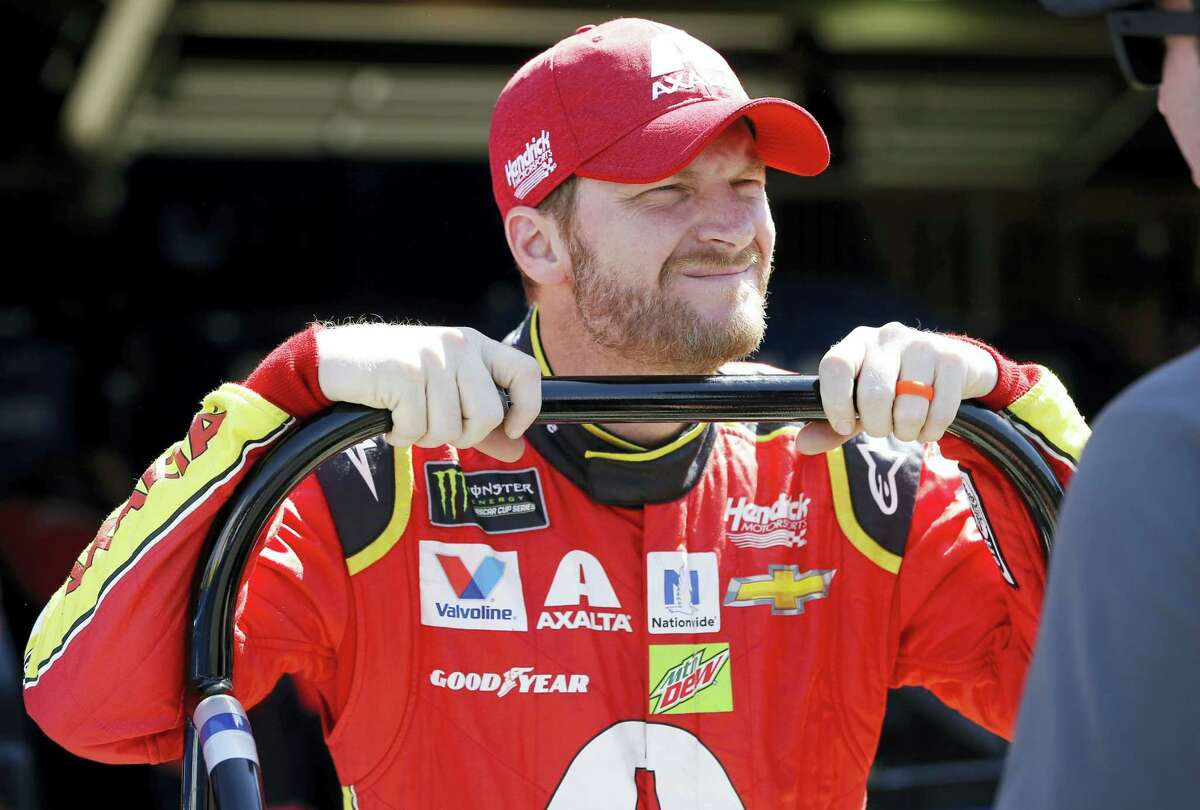 Dale Earnhardt Jr. waits in the garage area prior to the opening practice session in Fontana, California, on Friday.