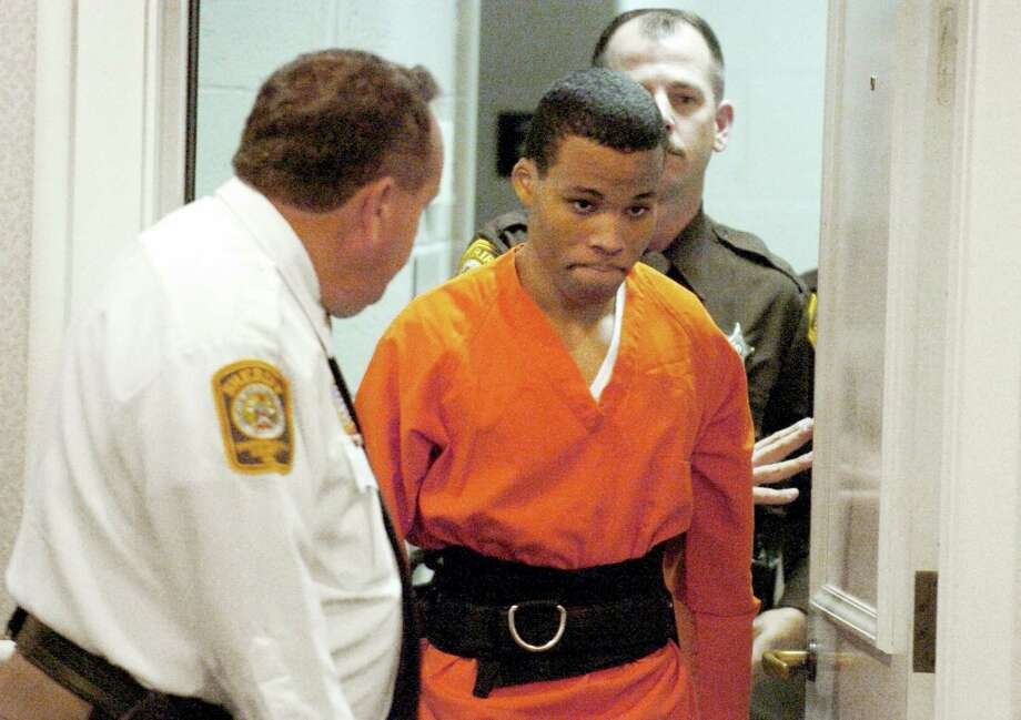 In this Oct. 26, 2004, file photo, Lee Boyd Malvo enters a courtroom in the Spotsylvania, Va., Circuit Court. A federal judge has tossed out two life sentences for D.C. sniper shooter Lee Boyd Malvo and ordered Virginia courts to hold new sentencing hearings. In a ruling issued Friday, U.S. District Judge Raymond Jackson in Norfolk said Malvo is entitled to new sentencing hearings after the U.S. Supreme Court ruled that mandatory life sentences for juveniles are unconstitutional. Photo: Mike Morones — The Free Lance-Star Via AP  / AP2006