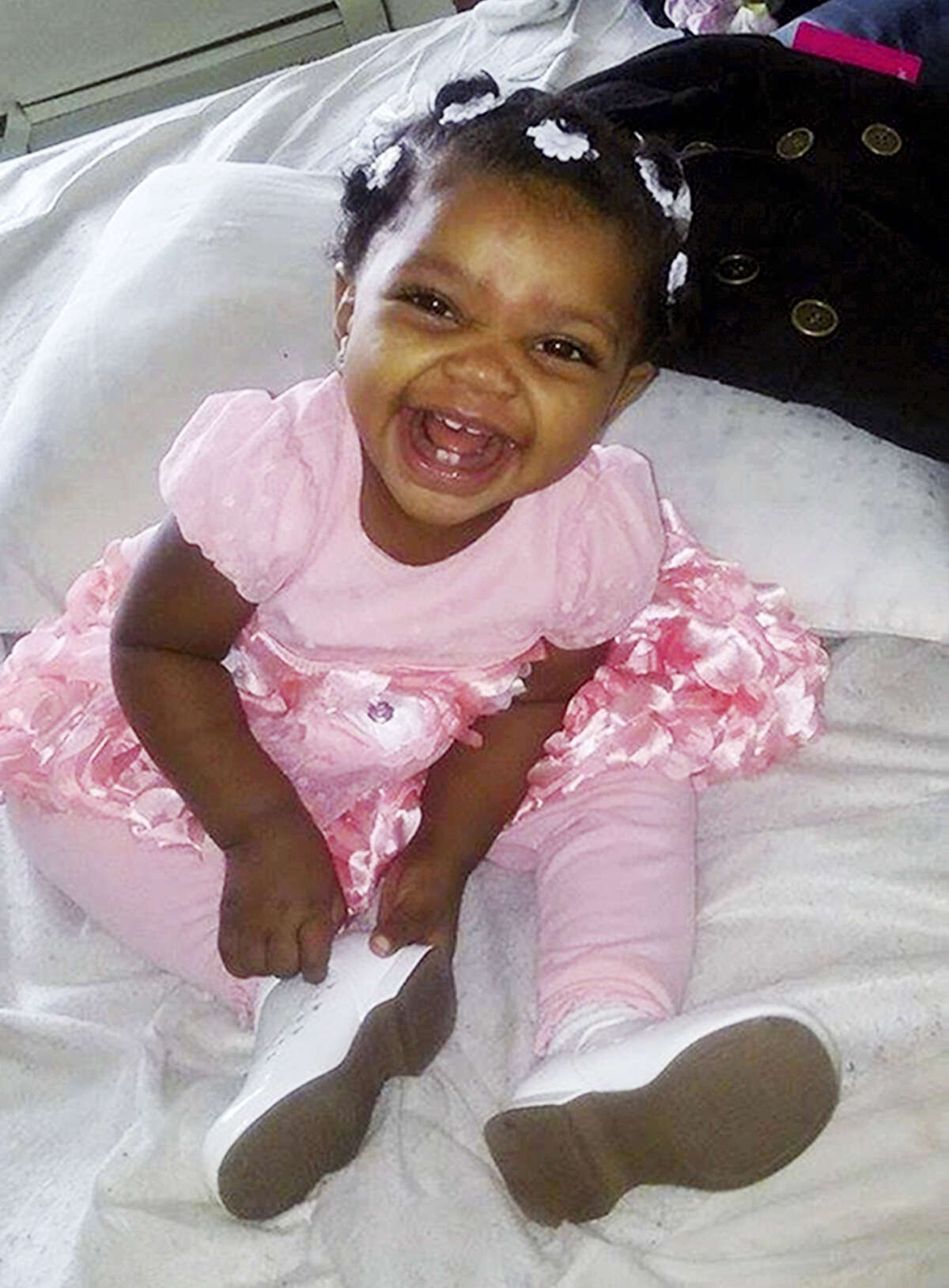 This photo provided by Helen Jackson shows Cataleya Tamekia-Damiah Wimberly before her 1st birthday party in Milwaukee. Wimberly died nearly three weeks later from a methadone overdose in a case the Milwaukee police are still investigating. The number of children's deaths is still small relative to the overall toll from opioids, but toddler fatalities have climbed steadily over the last 10 years.