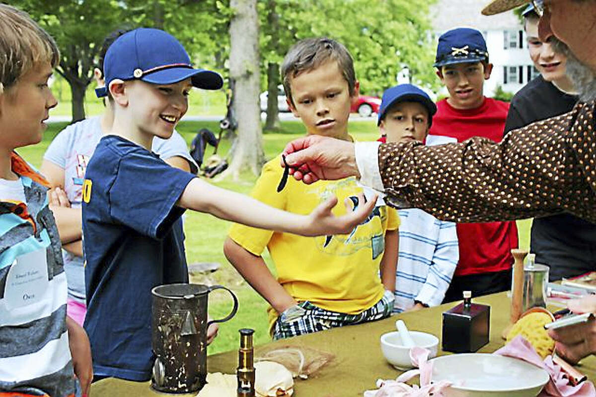 Children participate in an educational activity at the Litchfield Historical Society in 2016. The summer sessions resume in July and August; registration is now open.
