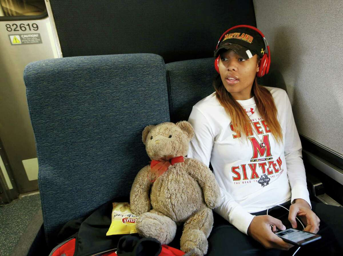 Maryland forward Kiah Gillespie sits beside Sirr, her lucky teddy bear, while riding an Amtrak Regional train from Baltimore to Stamford, Conn., Thursday. Only two Terrapins had ever taken a train, so the team's coach decided to take the train instead of a bus to the Bridgeport Regional of the NCAA women's college basketball tournament.
