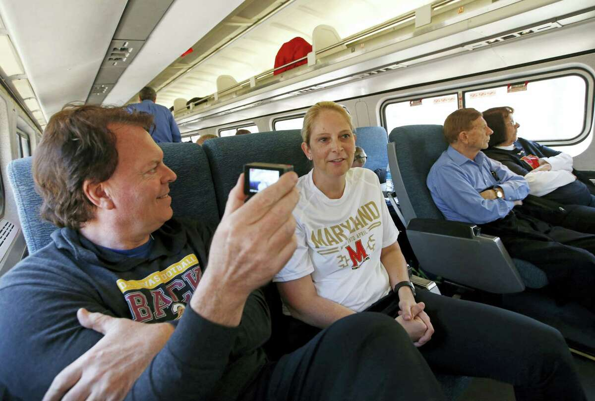 Maryland coach Brenda Frese, center, conducts an interview for a school staff member on board Amtrak Regional as the team headed from Baltimore to Stamford, Conn., Thursday. Frese wants to give her team new experiences so the two-time Big Ten Coach of the Year decided to have the Terrapins take the train instead of a bus to the Bridgeport Regional of the NCAA women's college basketball tournament. Freeze's parents, right, joined the trip.