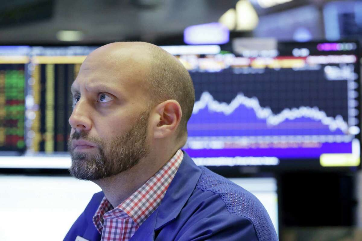Specialist Meric Greenbaum works at his post on the floor of the New York Stock Exchange Friday.