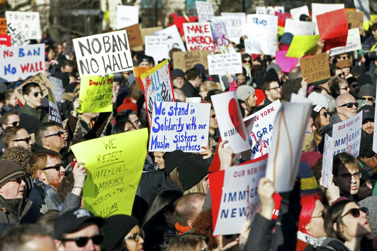 In this Jan. 29, 2017, file photo, protesters and immigrants' rights' advocates rally in opposition to President Donald Trump's immigration order at Battery Park in New York. In addition to spanning numerous demonstrations across the country, The American Civil Liberties Union said it is suddenly awash in donations and new members as it does battle with President Donald Trump over the extent of his constitutional authority.