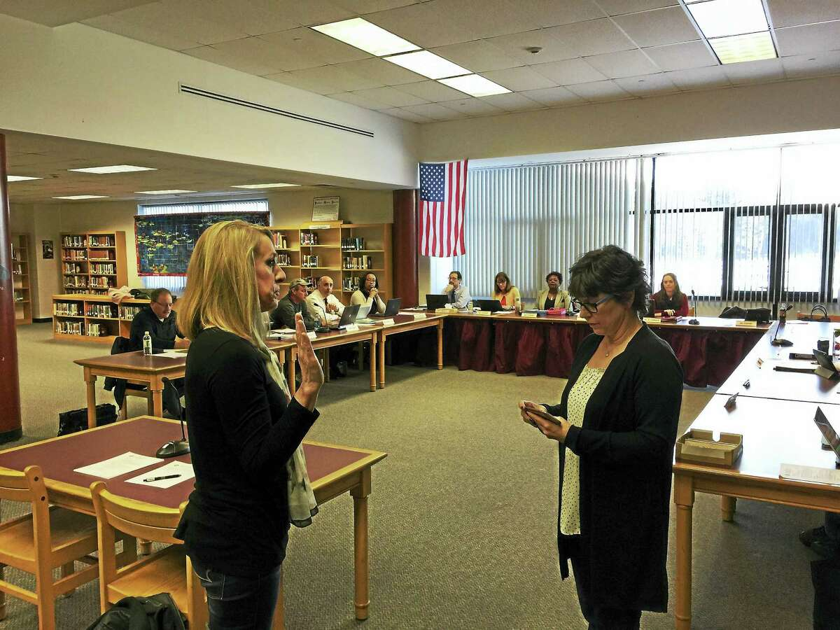 Wendy Pataky was appointed to the Torrington Board of Education Wednesday. Above, Pataky, left, is sworn in by member Ellen Hoehne.