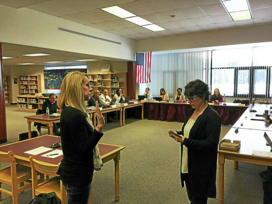 Wendy Pataky was appointed to the Torrington Board of Education Wednesday. Above, Pataky, left, is sworn in by member Ellen Hoehne. Photo: Ben Lambert — The Register Citizen