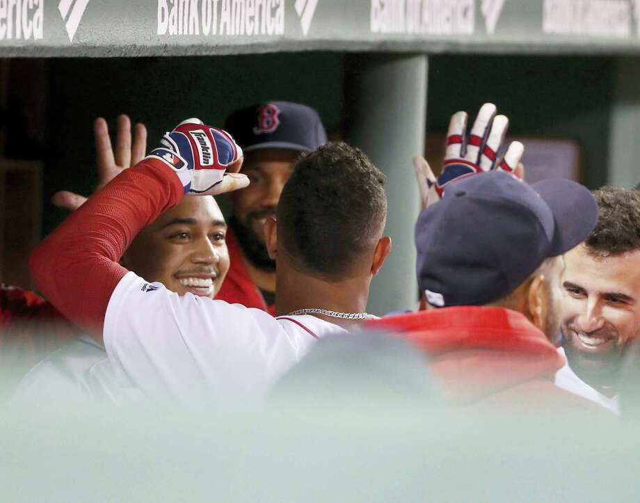 Teammates congratulate Xander Bogaerts after his home run in the third inning Thursday. Photo: The Associated Press   / FR158029 AP