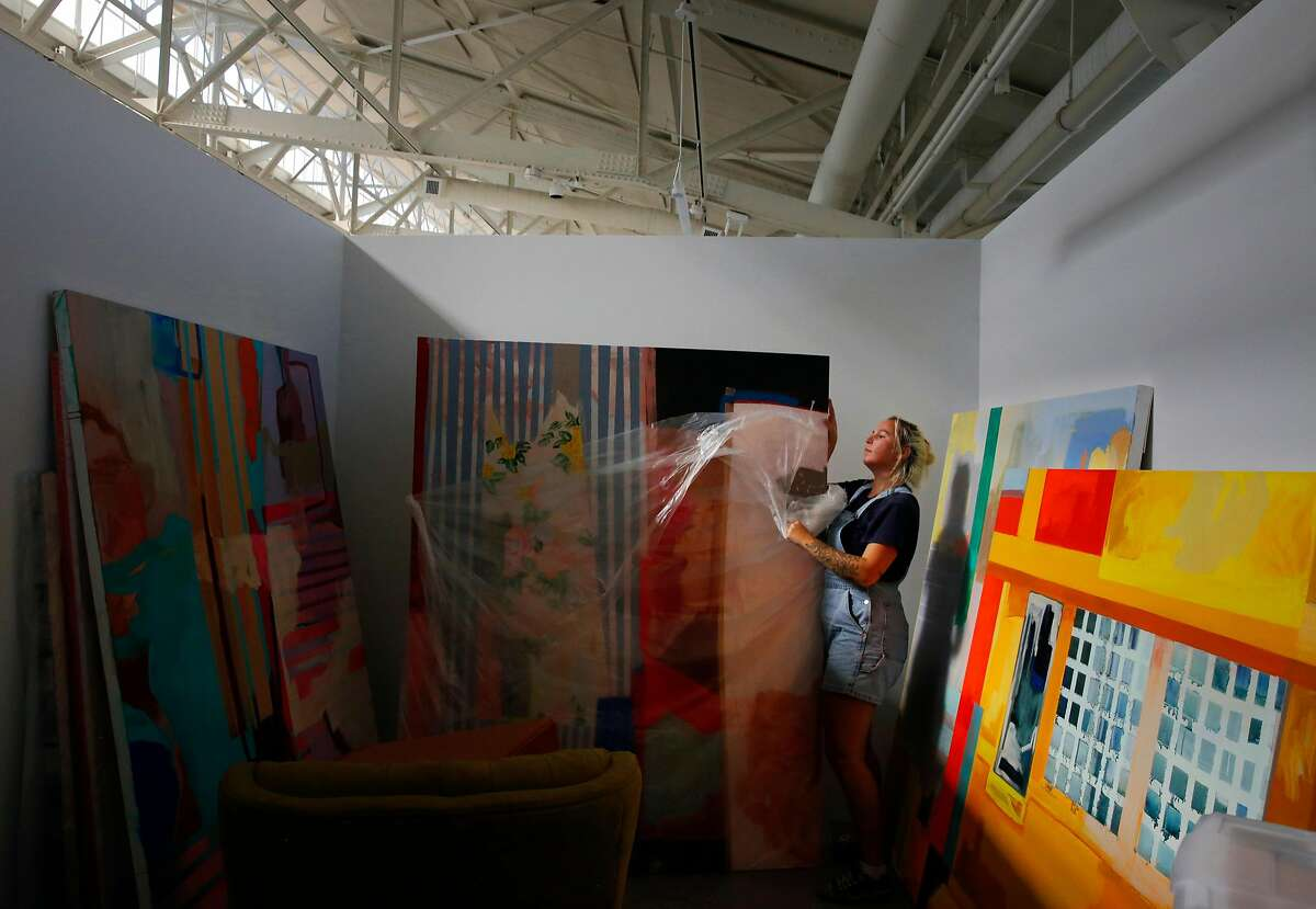 Second year MFA and MA student Jordan Holms moves her artwork and supplies into her new studio space after spending the entire day moving it into San Francisco Art Institute's new campus inside the remodeled historic Herbst Pavilion at the Fort Mason Center for Arts & Culture August 22, 2017 in San Francisco, Calif.