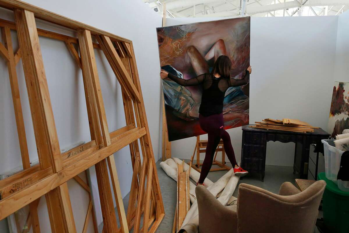 Second year MFA student Katherine Boxall arranges her work in her new studio space after spending the entire day moving her things to San Francisco Art Institute's new campus inside the remodeled historic Herbst Pavilion at the Fort Mason Center for Arts & Culture August 22, 2017 in San Francisco, Calif.
