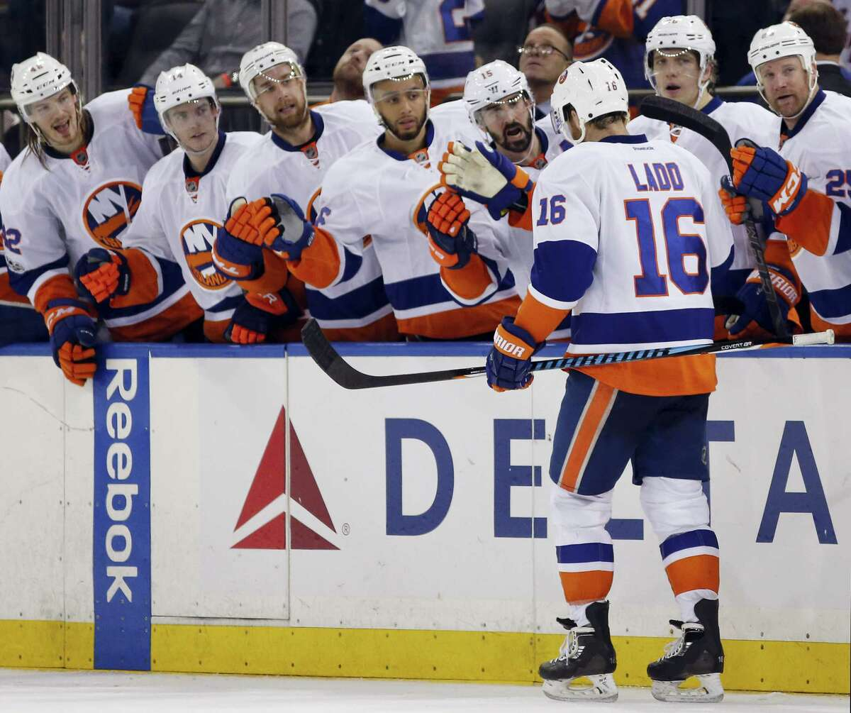 New York Islanders teammates greet left wing Andrew Ladd (16) who scored the game-winning goal in the third period of an NHL hockey game against the New York Rangers at Madison Square Garden in New York, Wednesday, March 22, 2017. The Islanders defeated the Rangers 3-2. (AP Photo/Kathy Willens)