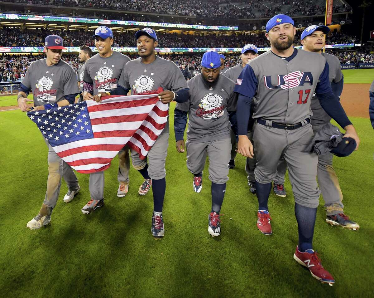 The U.S team celebrates an 8-0 win over Puerto Rico in the final of the World Baseball Classic in Los Angeles, Wednesday.