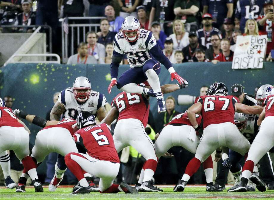 One of the rules NFL owners will consider proposals for next week will be eliminating players leaping over the line on kick plays. Photo: The Associated Press File Photo  / Copyright 2017 The Associated Press. All rights reserved.