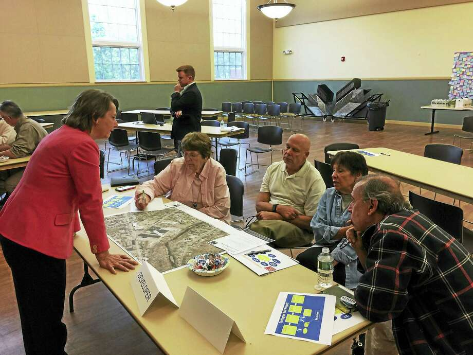 Torrington residents and officials considered the ins-and-outs of brownfield redevelopment during a recent meeting at City Hall. Photo: Ben Lambert — The Register Citizen