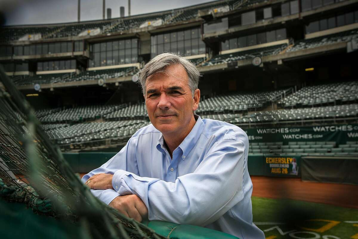Billy Beane stands portrait behind the Oakland A's batting cage at the Oakland Alameda County Coliseum in Oakland, Calif., on Monday, Aug. 14, 2017.
