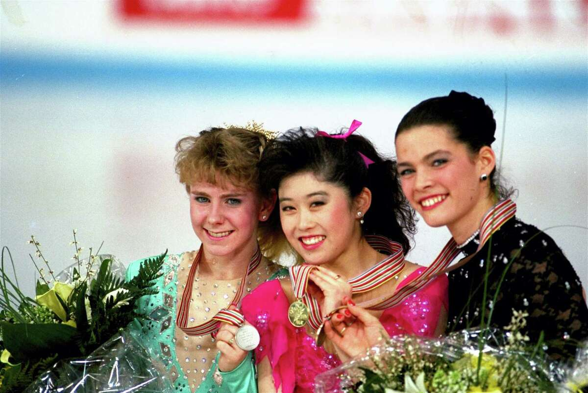 In this March 12, 1991, file photo, American skaters, from left, Tonya Harding, silver; Kristi Yamaguchi, gold; and Nancy Kerrigan, bronze, display their medals after the finals of the World Figure Skating Championships in Munich. A run-of-the-mill good luck tweet from Yamaguchi to Kerrigan is drawing online attention. Yamaguchi tweeted a message to Kerrigan ahead of Kerrigan's performance on Monday's 'Dancing with the Stars' March 20, 2017, and added 'break a leg.' Kerrigan was hit in the leg before the 1994 Winter Olympics by a man hired by the ex-husband of Harding. Yamaguchi's spokeswoman says 'no ill will was intended.'