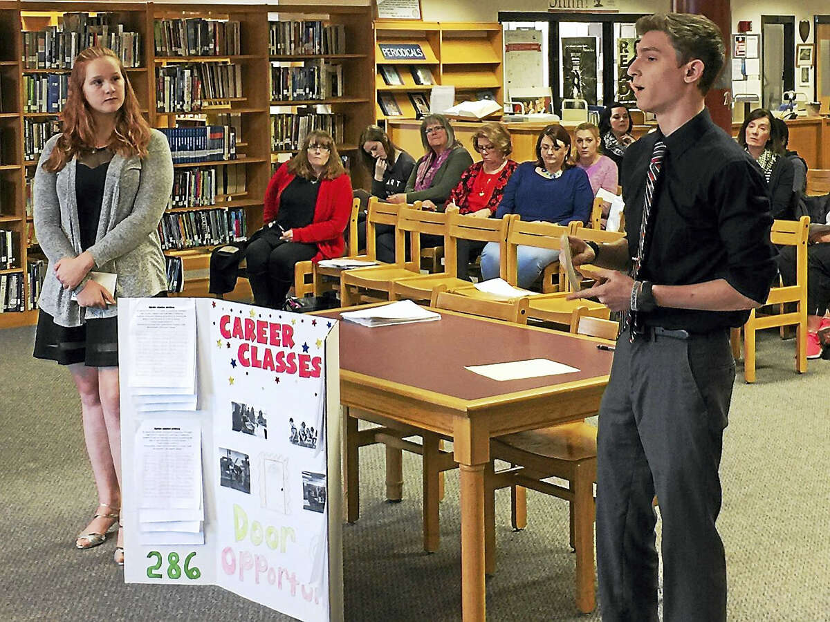 Ben Lambert - The Register Citizen Torrington High School students Jacob Koenig and Kiara Dwan speak as part of a hearing held Thursday on the proposed Torrington school budget for the 2017-18 fiscal year. The students made their case for keeping career-focused classes in the district.